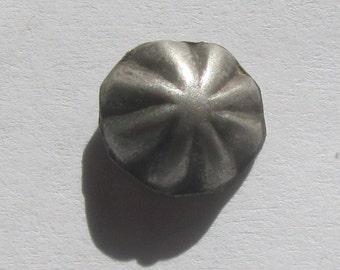 Antique diminutive Navajo silver repousse button