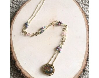 Acrylic pendant on gold chain with rhondite