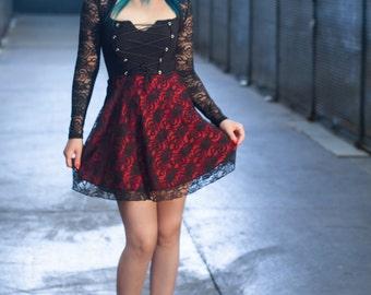 Sleeveless lace overlay corset style mini dress