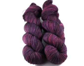 Jewelic Dark: 80/20 superwash BFL nylon twist sock yarn, handpainted