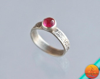Women's slender band silver ring with petite lab-created ruby, on a handmade fine silver band