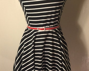 1980s-inspired black and white striped dress