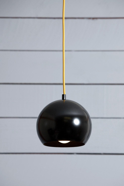 mid century pendant black eye ball light. Black Bedroom Furniture Sets. Home Design Ideas