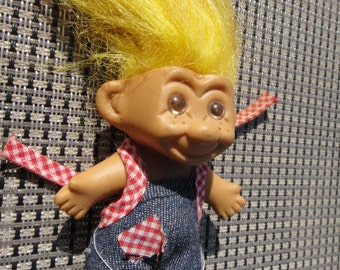Vintage Yellow Haired Troll With Freckles wearing denim overalls with red and white