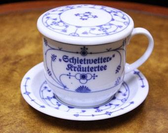 Covered German Coffee Mug and Saucer.