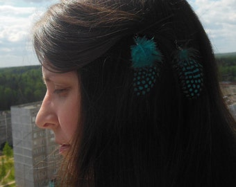 2 hair clips with feathers