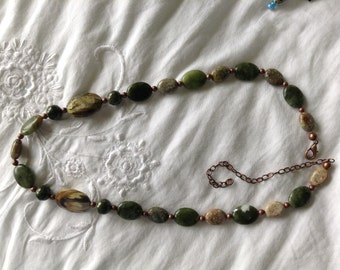 Green stone, resin, and copper bead necklace