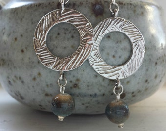 Earth tone jasper stone bead and textured silver hoop.