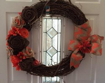 Salmon/orange and Brown grapevine wreath.