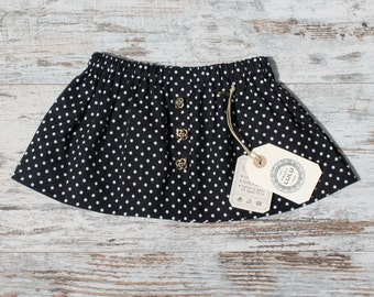 Skirt baby print dots - skirt with elastic waist and decorative buttons.