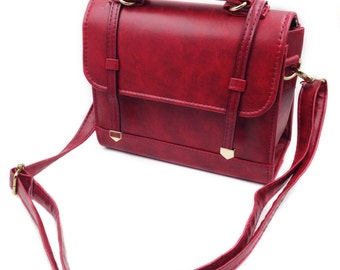 Red traditional leather bag