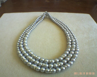 3 Strand 6 and 8mm glass pearl necklace.