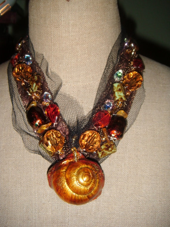 Necklace .    handmade  jevelry.  Boho jevelry. Colours; gold, brown, black, orange, blue. Ready to ship.