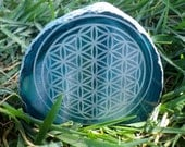 Standing Brazilian agate. Polished and laser etched with the flower of life