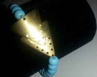 turquoise bracelet and triangle