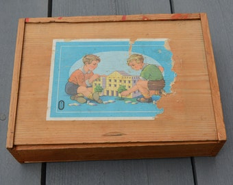 Wooden box with wooden building blocks