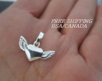 Silver heart and wings pendant; 92.5 sterling silver
