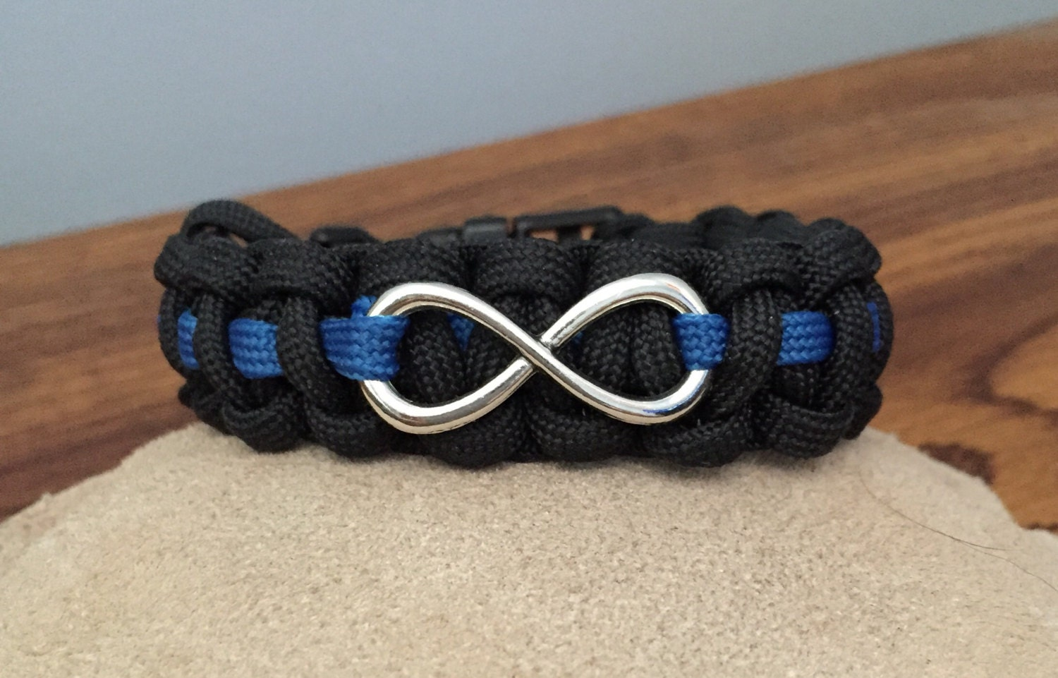 police thin blue line bracelet with infinity charm. Black Bedroom Furniture Sets. Home Design Ideas