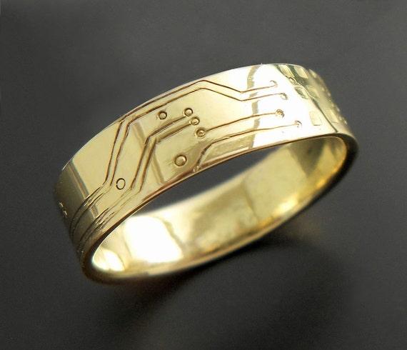 pair of custom gold circuit board wedding rings by bluekraken