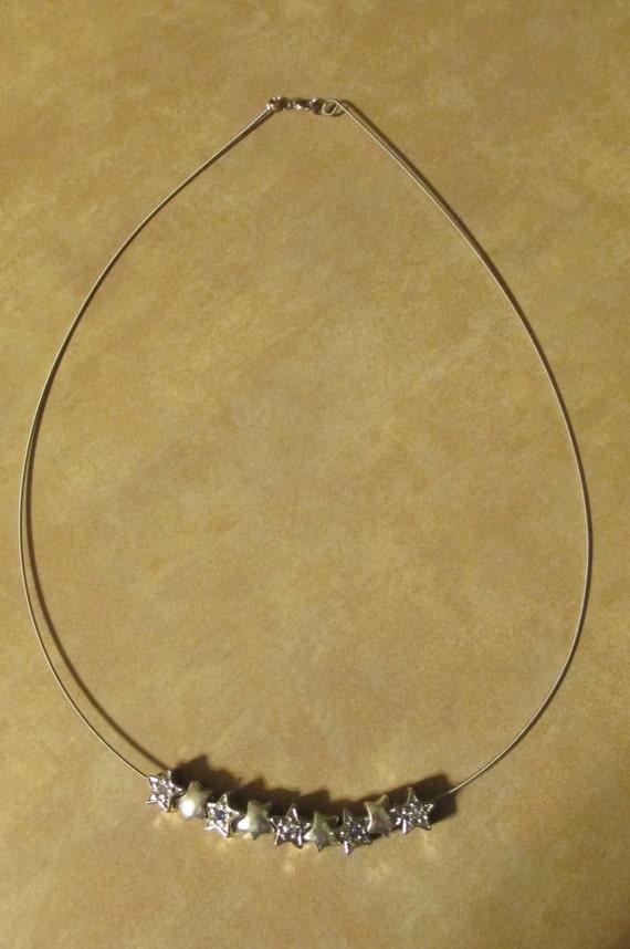 items similar to floating stars guitar string necklace on etsy. Black Bedroom Furniture Sets. Home Design Ideas