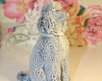 Realistic figurine Poodle of the marble chips