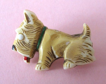 Very cute 1930's celluloid sitting dog brooch
