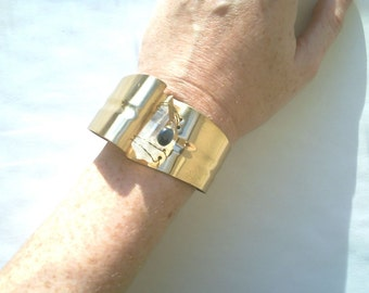 Cool unusual vintage artisan signed big brass cuff bracelet with quartz and cat's eye