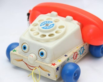 Telephone roulette Fisher Price