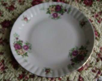 Polish china roses cake plate,white with ridged border decorated with red and yellow roses. Lovely for afternoon tea in Summer.