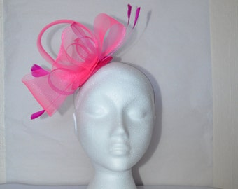 Pink fascinator with loops and feathers. Handmade