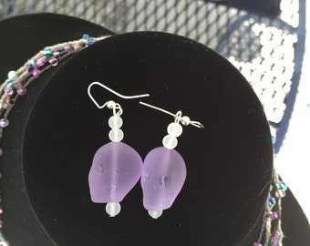 purple beach glass skull with white earrings