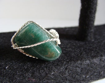 silver wrapped green stone