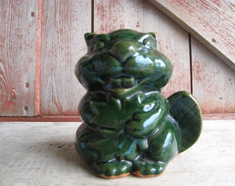 Vintage Green Clay Pottery Bucky Beaver Coin Bank Figurine With Cork Holding Maple Leaf