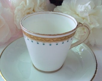 Antique demitasse cup and saucer