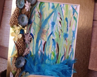 Tropical Seashell Wall Art with Feathers Limpet Shells and Burlap Blooms against a Tropical Watercolor on Wildflower Seeded Paper