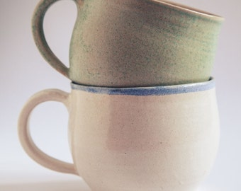 A Pair of Handcrafted Cups in White and Green