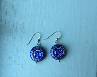 blue with white design earrings