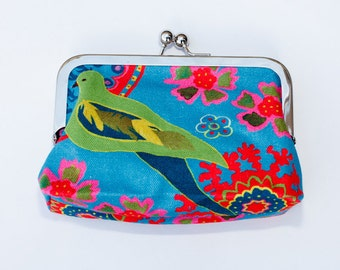 Little Green bird, beautifull hand made cotton purse, designed by Harriett Chapman with a spotty fabric lining and silver clasp.