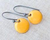 round torch fired enamel earrings yellow