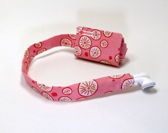 Pink and orange TuneTube.  Earbud cord organizer for iPhone or iPod.  Cord keeper.  Earbud holder.  Earbud case.