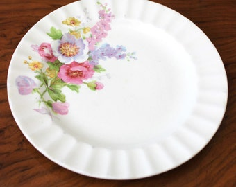Spring flowers. 1930s floral Edwin Knowles China bread and butter plate.