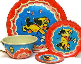 40's Tin Toy Tea Setting, Naughty Puppy, Cup & plates, 4 piece set.