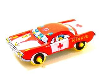 60s Tin Toy car, Vintage red emergency vehicle, KINKYU. Made in Japan.