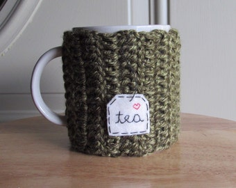 Crocheted tea cup cozy tea mug cozy in moss green with hand embroidered tea patch