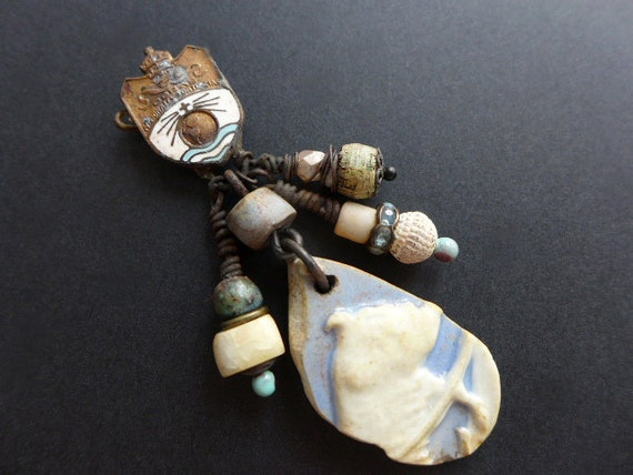 Cyaneous. Baby blue rustic cluster brooch with sea pottery.
