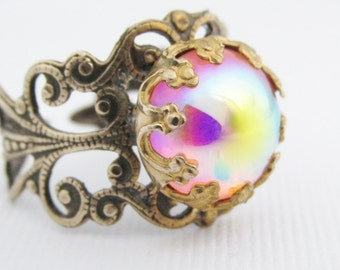 Adjustable Pink Ring, Irridescent Colorful Ring, Antique Brass filigree Band, Rainbow Ring, Glass Cabochon Stone