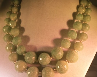 A Vintage Double Strand Necklace with Pale Green Plastic, Frosted, Faceted Beads