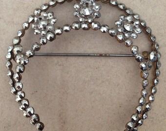 Cut steel crescent brooch