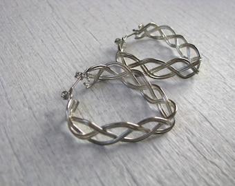 Silver tone openwork heart earrings with post lever backs for pierced ears