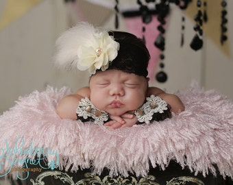 Baby in Paris, newborn photography, newborn headband and lace arm cuffs